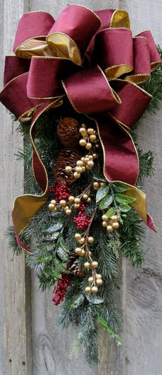 Christmas Swag, Holiday Wreaths, Victorian, Elegant, Designer Door Decor. Frosted and natural pine boughs are accented by burgundy clusters of