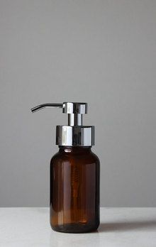 Our Amber Glass Apothecary Style Foaming Soap Dispenser features a metal foaming pump with stainless finish and handsome amber base; Fill and refill with your favorite foaming soap and sit sink side for a stylish touch. Recycled Glass Bottles, Glass Spray Bottle, Bottle Candles, Amber Glass Bottles, Bathroom Soap Dispenser, Soap Dispensers, Apothecary Decor, Glass Bathroom, Bathroom Ideas