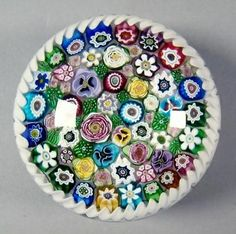 """Parabelle Paperweight Signed Artisit Proof 1998. Close pack in white torsade. 2 1/8"""" x 3 1/4"""