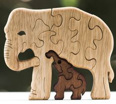 A mom Elephant with its baby. This is one of my favorite designs. One of my first most favorite puzzle. My brother helped me design him, and he did a good job because he is in the top 3 best sellers! The baby painted in brown, American walnut.  Dimensions: 16 cm * 13 cm Thickness: 21 mm. They all come out real nice. :)  You can also find in my shop, a penguin with his baby: https://www.etsy.com/il-en/shop/Puzzleson?ref=hdr_shop_menu&search_query=penguin+...