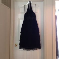 Sexy black cocktail dress  B.MOSS B.MOSS black cocktail dress. Halter top. Ruffles down. Very flattering on. Good condition. Dry cleaned. This dress is HOT, HOT, HOT!! Perfect for a fancy date or event! B. Moss Dresses