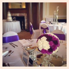 Carnation ball centerpiece and floating candle with submerged calla lilies in cylinders in the back ground. Combination Centerpieces.