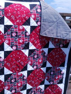 University of Alabama quilt is done in a Snowball pattern. It has loads of color.The colors include two different Alabama prints along with black and