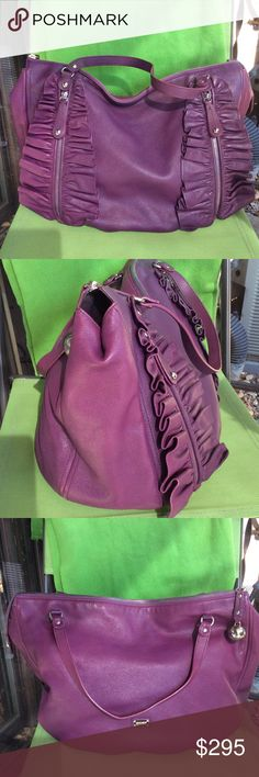 MOSCHINO cheap and chic large leather bag Beautiful purple leather ,,some wear on back corners like slightly discoloration one Zipper pocket inside and two outside Moschino Bags Shoulder Bags