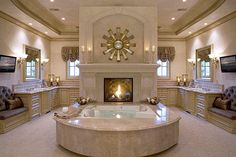 #BATHROOMGOALS - Bathroom with fireplace in front of a two-person tub!