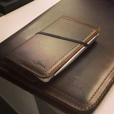 Notepad holder and moleskine.
