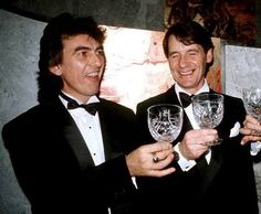 George with Michael Palin in September 1988 at a posh party celebrating Handmade Films
