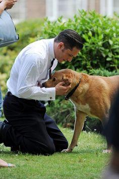 Tom Hardy Photos - Tom Hardy Cuddles with a Dog - Zimbio