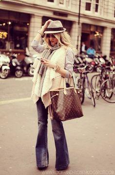 Street Style -- felt hat, flowy vest, flared jeans.