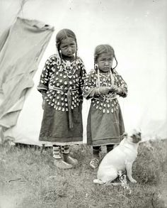 2 Crow Girls & a dog. Montana. Early 1900s.