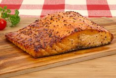 Cedar-Planked Salmon with Maple-Mustard Glaze. Notes: Soak plank for 6 hours, dry off top of board and rub with veg oil, marinate salmon for 1 hour before grilling (use only half the marinade of maple syrup & grainy mustard), salt salmon just before grilling. For 1 inch thickness, leave on grill for 30 mins with cover on. Half way through, baste with remaining marinade.