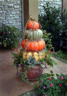 Fall Decorating ~ Pumpkin Topiary! using yellow, blue and orange pumpkins in an urn, with plants for accents. Unique Design