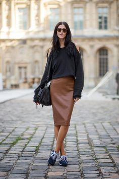 brown leather skirt, cut out shoulder blouse and sneakers, street style inspiration, streetwear