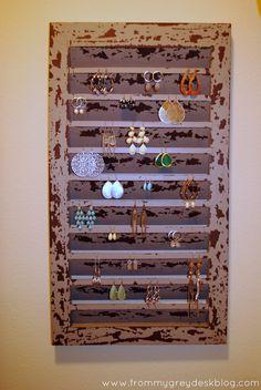 From My Grey Desk Blog: Lauren had such a cute idea for organizing dangle earrings on an old window shutter.