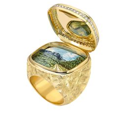 The Ring opens to reveal a hand-painted enamel scene of a long a winding road leading back home. 2