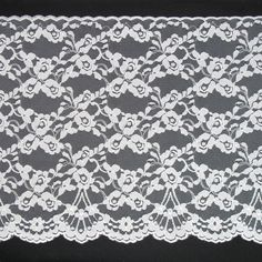 225mm white raschel lace with floral pattern, $3.00 per meter. http://www.alacraft.com.au/225mm-white-raschel-lace-with-floral-pattern-2590.    Scalloped edges, delicate light weight, floral vine design. 100 percent nylon. Ideal for clothing, bridal wear, lingerie, costumes, dance wear and soft furnishings.