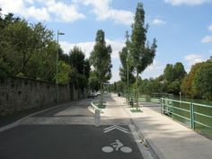 TRAFFIC CALMING, speed table and pinch on Marne River. Love that Frenchie cyclist symbol!