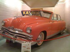 Kaiser in Indian Ceramic (Coral) at the Harold Lemay Family Car Museum.