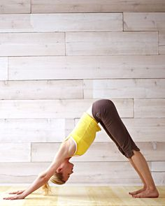 Yoga  - Downward Dog                                     Curl your toes, take a breath, and, as you exhale, press into your hands, lifting your hips back. Holding the pose, keep your spine straight (bending your knees if need be) and your weight resting evenly between the legs and arms.