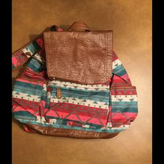LAST ONE  MAKE OFFER Aeropostale Backpack ! ❤️ Aeropostale Aztec designed backpack ! 2 side pockets ! Zip front compartment ! Magnetic snap closure ! Vegan leather on flap bottom and drawstrings ! It is a dark grey inside ! The colors are turquoise reds and browns ! A beauty ! ❤️ Aeropostale Bags Backpacks