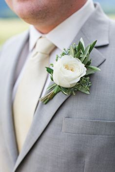 This could also work babe??  I love this look for the groom! Light gray suit, light cream tie, and white boutonnière