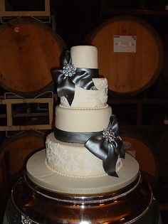 Charcoal gray gumpaste bows with broaches wedding cake
