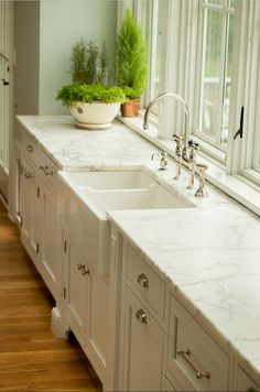 Kitchen. Calacatta gold -coastal home - kitchen countertops -marble countertops -natural stone countertop -white kitchen #Kitchen #Countertop #HonedMarble #CalacattaGold
