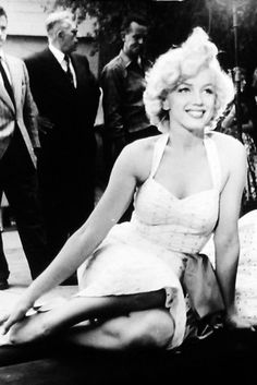 Marilyn Monroe photographed during her handprint ceremony at Grauman's Chinese Theater, 1953.