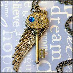 Steampunk Key Pendant - Angel Wing Series - Genuine Swarovski Crystal - Vintage Rubis Jewels Watch Movement. 48.00, via Etsy.