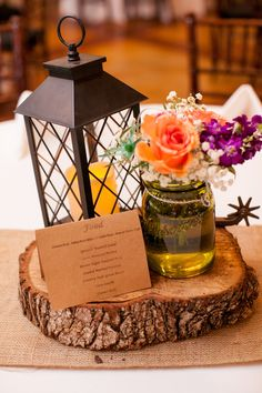 Rustic chic centerpieces with lantern, mason jar, and spur Photographer: Jeremy & Kristin Venue: The Orchard Event Venue www.theorchardtx.com. Hidden in a quiet corner of the Fort Worth metroplex is The Orchard, a new, state of the art venue that will serve as the perfect backdrop for all of life's special occasions. Outdoor Wedding Venue | Fort Worth Wedding Venue | Rustic Wedding Venue | Country Wedding Venue | Elegant Wedding Venue