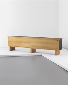CHARLOTTE PERRIAND Large 'Bahut' sideboard, c. 1960  Oak, oak veneered-wood, painted metal, plastic. 81 x 312 x 46 cm. (31 7/8 x 118 7/8 x 18 1/8 in.) Editioned by Galerie Steph Simon, France. Each drawer moulded with 'MODELE CHARLOTTE PERRIAND/BREVETE S.G.D.G'.
