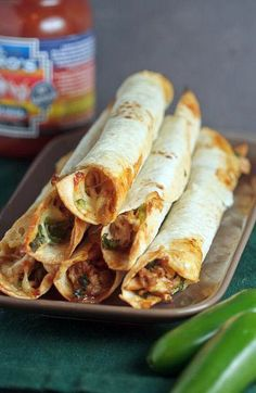 (Baked Chicken and Spinach Flautas ) .. Healthy taquitos! Chicken and Spinach....Baked not fried..