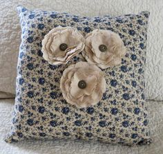 Isn't this the prettiest navy floral calico material.  I made it in to a pillow and added tea-stained linen flowers secured with antiqued gold buttons.