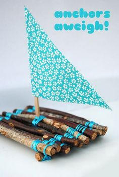 Cute Twig Boats. Kids made boat from twigs and yarn- fun to make and then to play with!