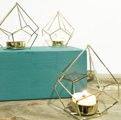 Your Woodfire tealights are begging for a special place to display them. This gorgeous gold geometric holder is the perfect place. It's modern design will be sure to add to ambiance of your home or ev