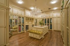 large custom dressing room with center island, seating & huge crystal chandelier - dreaming
