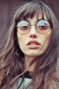nose ring bangs and round frame sunnies