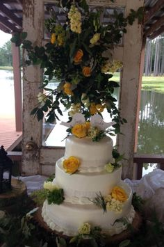 3 tired wedding cake decorated with lace fondant adorned spray roses, stock, hypericum berries and green dianthus. Cake designed by Flowers by the Bunch