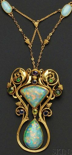 Art Nouveau Opal and Gem-set Pendant Necklace, F.G. Hale, bezel-set with two shaped opal cabochons  further bezel-set with amethyst, sapphire, peridot, green tourmaline, and demantoid garnets. Foliate mount with grape cluster motifs, suspended from a conforming chain with two bezel-set opal cabochons with black onyx backs,