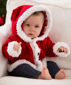 Free Knitting Pattern for Santa Baby Sweater - This is adorable and easy. Easy hooded baby cardigan with a fuzzy trim designed by Lorna Miser for Red Heart in sizes 3mos, 6 mos, 12 mos, 18 mos, and 24 mos.