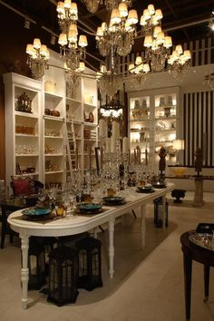 Store interior with large chandelier and white table