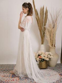 Lace bohemian wedding dress with volume sleeves, flattering v neck line and open back framed with lace trim, elegant train and full light wight skirt with lace trim hem.This magnificent wedding dress is made from soft lace and stretch golden lining. It is comfortable, luxurious and the perfect show-stopping style for a free spirited boho bride. Details:- Handmade to your custom size. - Flattering v-neckline and low back adorn with lace trim.- Bohemian details as floral lace, volume sleeves… Half Sleeve Wedding Dress, Indie Wedding Dress, Backyard Wedding Dresses, Ivory Lace Wedding Dress, Wedding Dresses Photos, Bohemian Wedding Dresses, Dream Wedding Dresses, Bohemian Weddings, Bohemian Bride