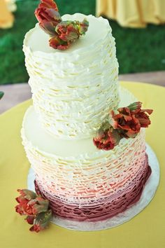 ombre ruffle cake with real flowers