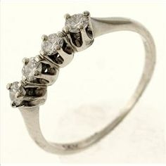 1.4 Gram 14kt White Gold Ring With Diamond Accents  http://www.propertyroom.com/l/14-gram-14kt-white-gold-ring-with-diamond-accents/9553858