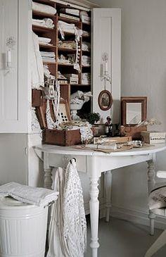 makeshift secretary...drop leaf table tucked against armoire'