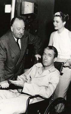 Grace Kelly, James Stewart and Alfred Hitchcock on the set of Rear Window (Hitchcock, 1954)