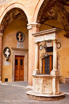 Water well in the courtyard in Siena, Tuscany, Italy by Brain Jannsen