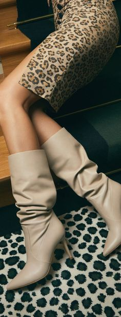 Channel Gianvito Rossi's modern elegance with the Hansen 85 knee-high boots. Fresh for winter in off-white leather, they can be worn high on the legs or gathered in a slouch-fit. Our editors suggest a cocoon coat and cashmere sweater dress for looks speaking the language of sophistication. ❤ #boots #fallboots #winterboots #womensboots #fallfashion #streetfashion #fall2020fashion #winter2020fashion Knee High Boots, Ankle Boots, Women's Boots, Cashmere Sweater Dress, Designer Boots, Cool Boots, Winter Boots, White Leather, Combat Boots