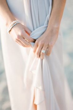 pretty picture of the little details. Ring, dress, and bracelets