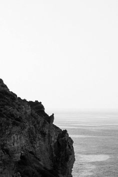 Free download of this photo: https://www.pexels.com/photo/grayscale-photo-of-rocky-cliff-by-the-sea-at-daytime-200160/ #sea #black-and-white #landscape